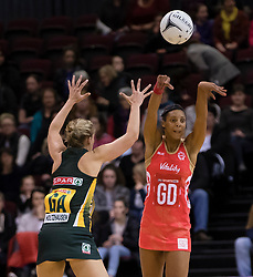 England's Stacey Francis, right, passes the ball as South Africa's Maryka Holtzhausen looks to block in the Netball Quad Series netball match, ILT Stadium Southland, Invercargill, New Zealand, Sept. 3 2017.  Credit:SNPA / Adam Binns ** NO ARCHIVING**