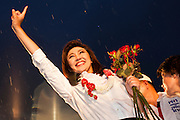 01 JULY 2011 - BANGKOK, THAILAND:  YINGLUCK SHINAWATRA, leader of the Pheua Thai party, greets voters in the rain at the last Pheua Thai rally of the year in Bangkok Friday. Thailand's divisive election campaign drew to a close Friday in Bangkok. Most of the parties had large rallies in an effort to sway last minute undecided voters. Pheua Thai, the party of ousted Prime Minister Thaksin Shinawatra held a massive rally in Rajamakala Stadium (also called Ramkamhaeng Stadium) to close out their campaign. A monsoon thunderstorm didn't keep people away from the event. Most Thai public opinion polls show Pheua Thai with a healthy lead over their arch rivals (and incumbent party in power) the Democrats. Thaksin's youngest sister, Yingluck Shinawatra, is running for Prime Minister under the Pheua Thai banner. If elected, she will be Thailand's first female Prime Minister.      PHOTO BY JACK KURTZ