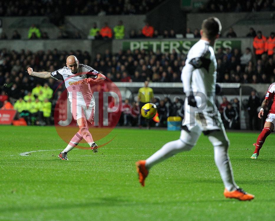 Swansea City's Jonjo Shelvey shoots at goal. - Photo mandatory by-line: Alex James/JMP - Tel: Mobile: 07966 386802 28/01/2014 - SPORT - FOOTBALL - Liberty Stadium - Swansea - Swansea City v Fulham - Barclays Premier League
