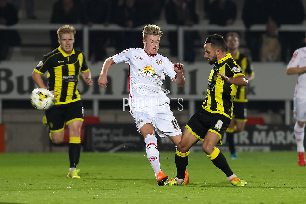 Burton Albion midfielder Robbie Weir on the end of a hard challenge from Crewe Alexandra midfielder Adam King during the Sky Bet League 1 match between Burton Albion and Crewe Alexandra at the Pirelli Stadium, Burton upon Trent, England on 20 October 2015. Photo by Aaron Lupton.