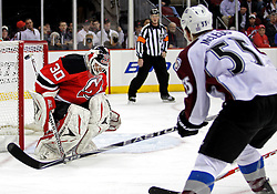 Oct 15; Newark, NJ, USA; Colorado Avalanche left wing Cody McLeod (55) scores a goal on New Jersey Devils goalie Martin Brodeur (30) during the first period at the Prudential Center.