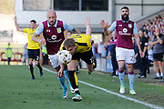 Burton Albion striker Cauley Woodrow (12) chases the ball against Aston Villa defender Alan Hutton (21) during the EFL Sky Bet Championship match between Burton Albion and Aston Villa at the Pirelli Stadium, Burton upon Trent, England on 8 April 2017. Photo by Richard Holmes.