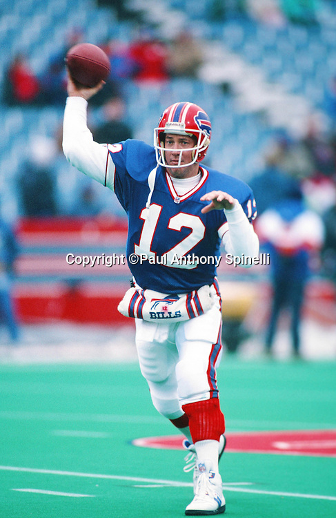 Buffalo Bills quarterback Jim Kelly (12) throws a pass while warming up before the NFL football game against the Denver Broncos on Dec. 12, 1992 in Orchard Park, N.Y. The Bills won the game 27-17. (©Paul Anthony Spinelli)