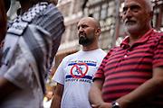 Frankfurt am Main | 26 July 2014<br /> <br /> Am Samstag (26.07.2014) demonstrierten etwa 500 Menschen auf dem R&ouml;merberg in Frankfurt am Main f&uuml;r Frieden in Pal&auml;stina / Gaza und f&uuml;r ein sofortiges Ende der israelischen Milit&auml;reins&auml;tze dort.<br /> Hier: Ein Teilnehmer der Demo tr&auml;gt ein T-Shirt mit der Aufschrift &quot;Free Palestine - Boycott Israel&quot; und einer israelischen Flagge, bei der der Davidstern durchgestrichen ist.<br /> <br /> &copy;peter-juelich.com<br /> <br /> FOTO HONORARPFLICHTIG!<br /> <br /> [No Model Release | No Property Release]