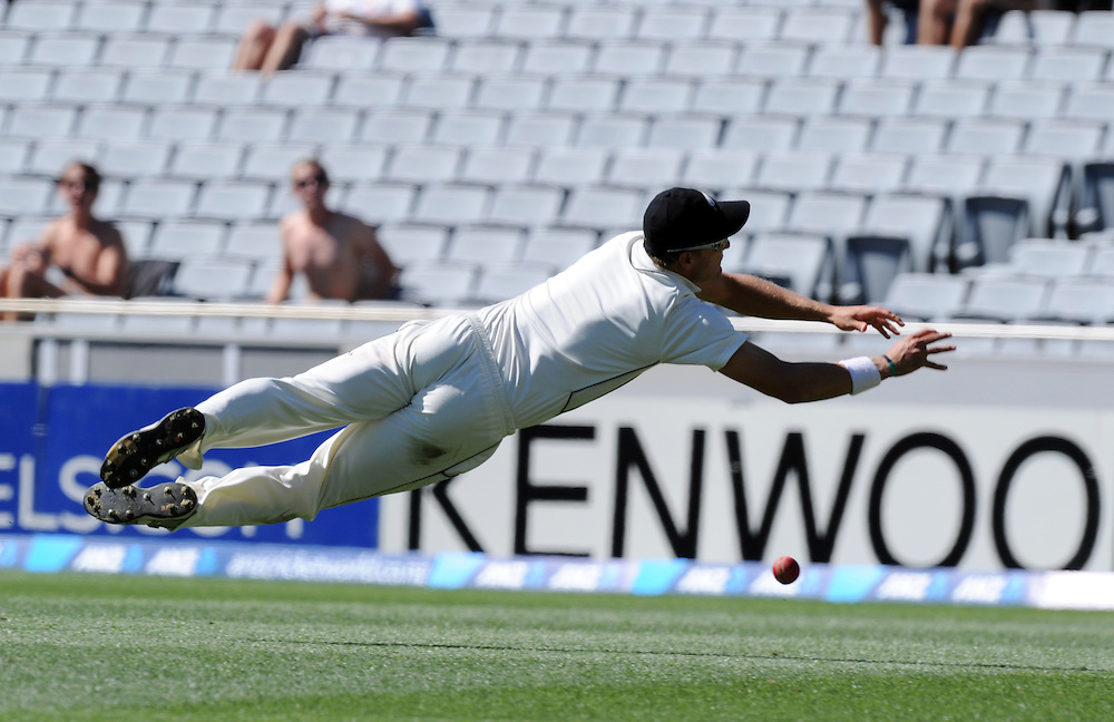 New Zealand's Neil Wagner dives unsuccessfully to take a catch off the batting of England's Matt Prior on the fifth day of the 3rd international cricket test, Eden Park, Auckland, New Zealand, Tuesday, March 26, 2013. Credit:SNPA / Ross Setford