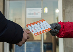Scottish Labour launch a leaflet promoting their rail fare freeze policy, as well as a further breakdown of the impact of a rail fare freeze.  The leaflet is in the style of a rail ticket.  <br /> <br /> Pictured: Scottish Labour activists handing out the new Fare Freeze leaflet