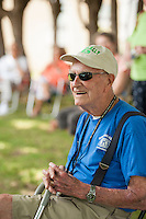 John Mullally listens as John Hall speaks to the crowd during the 70th Anniversary celebration of the Kiwanis Pool in St. Johnsbury Vermont.  Karen Bobotas / for Kiwanis International