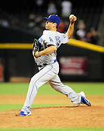 Sep. 27 2011; Phoenix, AZ, USA; Los Angeles Dodgers pitcher Javy Guerra(54) delivers a pitch during the tenth inning against the Arizona Diamondbacks at Chase Field. The Diamondbacks defeated the Dodgers 7-6 in extra innings.    Mandatory Credit: Jennifer Stewart-US PRESSWIRE.