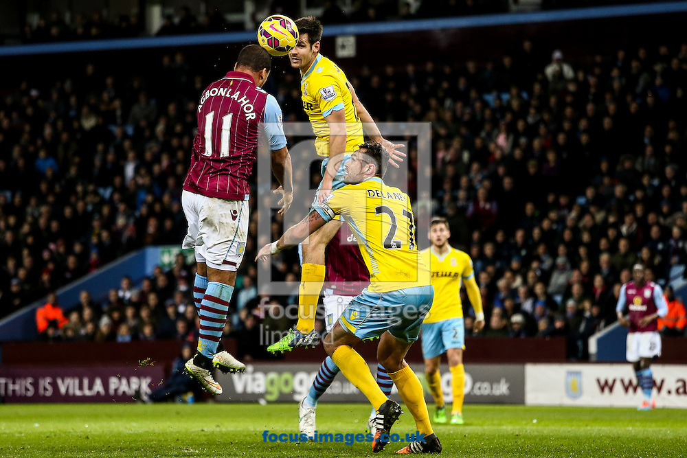 Gabriel Agbonlahor of Aston Villa (left)  heads at goal during the Barclays Premier League match at Villa Park, Birmingham<br /> Picture by Andy Kearns/Focus Images Ltd 0781 864 4264<br /> 01/01/2015