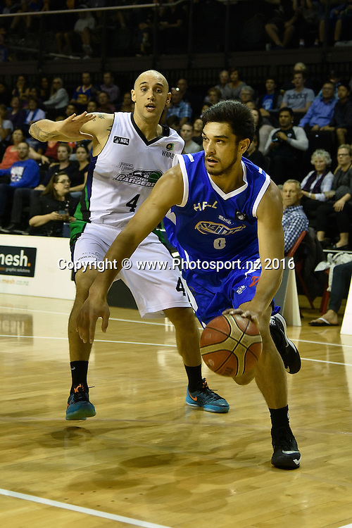 Shea Lli (R of the Saints runs past Lindsay Tait of the Rangers during the NBL Wellington Saints vs Super City Rangers basketball match at the TSB Arena in Wellington on Thursday the 10th of March 2016. Photo by Marty Melville / www.Photosport.nz