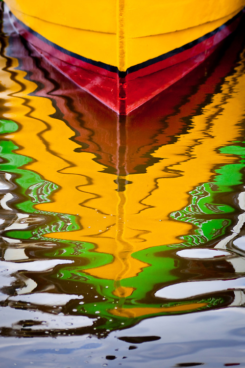 Reflections of colorful tour boats on Ilha do Mel (Honey Island), Brazil, South America