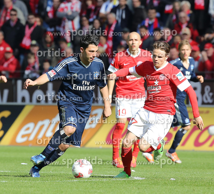 13.04.2013, Coface Arena, Mainz, GER, 1. FBL, 1. FSV Mainz 05 vs Hamburger SV, 29. Runde, im Bild Tolgay Arslan (HSV) gegen Nicolai Mueller (Mainz) // during the German Bundesliga 29th round match between 1. FSV Mainz 05 and 29X at the Coface Arena, Mainz, Germany on 2013/04/13. EXPA Pictures © 2013, PhotoCredit: EXPA/ Eibner/ Neurohr..***** ATTENTION - OUT OF GER *****