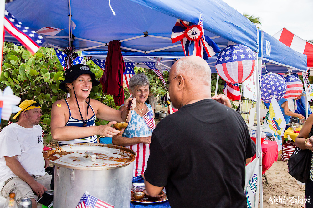 Mary Ho, left, and Betsy Shehan serve Betsy's All American Chili.  31st Annual Texas Society Chilli Cookoff Brewers Bay.  St. Thomas, USVI.  16 August 2015.  © Aisha-Zakiya Boyd