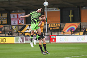 Forest Green Rovers Kevin Dawson(18) out jumps Cambridge United's Liam O'Neil(8) during the EFL Sky Bet League 2 match between Cambridge United and Forest Green Rovers at the Cambs Glass Stadium, Cambridge, England on 7 September 2019.