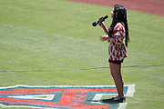 ANAHEIM, CA - JULY 10:  A singer sings the National Anthem before the Los Angeles Angels of Anaheim game against the Seattle Mariners on July 10, 2011 at Angel Stadium in Anaheim, California. (Photo by Paul Spinelli/MLB Photos via Getty Images)