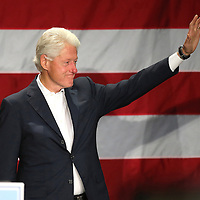 Former President Bill Clinton walks onto the stage during a campaign event for former Florida Republican governor Charlie Crist, who is running against current Republican Florida Gov. Rick Scott, at the UCF Arena on Monday, Nov. 3, 2014 in Orlando, Florida. (AP Photo/Alex Menendez)