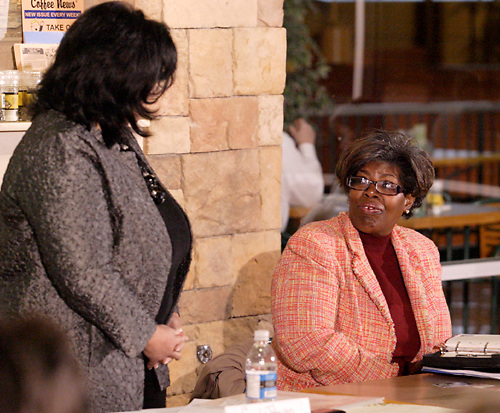 Gail Johnson of Cognitians, LLC (left) and Rosalyn Smith of Soul Purpose during the Women in Business Networking 'Hot Topics' Koffee Talk at the Dorothy Lane Market in Springboro, Friday, March 4, 2011.