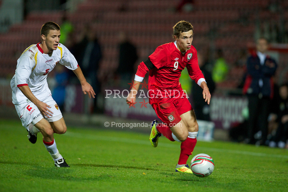 WREXHAM, WALES - Saturday, October 8, 2011: Wales' Tom Bradshaw in action against Montenegro during the UEFA Under-21 Championship Qualifying Group 3 match at the Racecourse Ground. (Pic by David Rawcliffe/Propaganda)