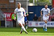 Leeds United midfielder Adam Forshaw (4) passes the ball during the EFL Sky Bet Championship match between Wigan Athletic and Leeds United at the DW Stadium, Wigan, England on 17 August 2019.