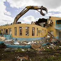 Demolition. of a 1930s vintage appartment building at NE 5th Ave. and 26th Terrace.  Image from a series called Paradise Lost, the changing face of Miami.