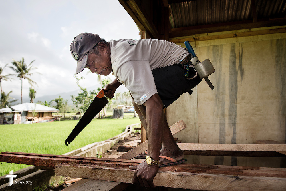 A worker prepares wood for a new parsonage next to Christ Lutheran Church in Mayahag, Leyte Province, Philippines, on Saturday, March 15, 2014.  LCMS Communications/Erik M. Lunsford