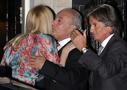 ©London News pictures. 21.02.2011. Topshop owner Sir Philip Green hugs super model Claudia Schiffer at an event at No 10 Downing Street hosted by Prime Minister's wife Samantha Cameron to celebrate the UK's fashion industry. Picture Credit should read Carmen Valino/LNP