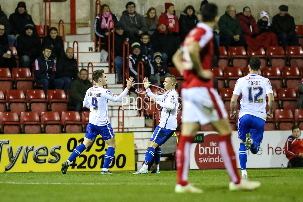 Walsall's Tom Bradshaw is congratulated for scoring the equalising goal during the Sky Bet League 1 match between Swindon Town and Walsall at the County Ground, Swindon, England on 24 November 2015. Photo by Shane Healey.