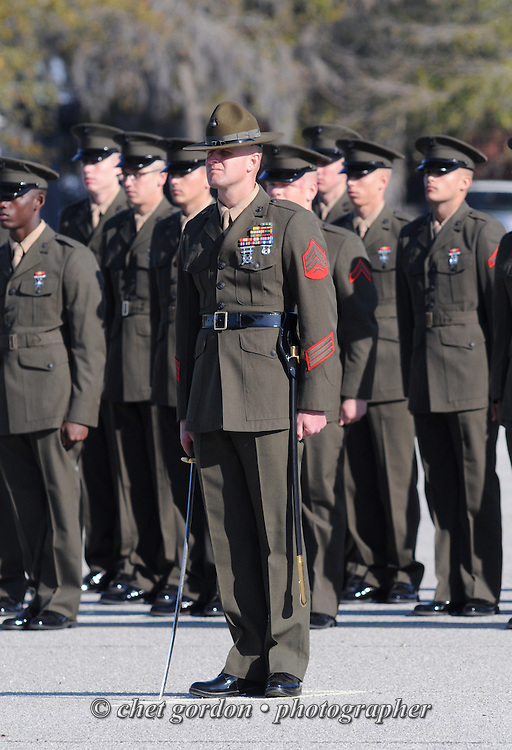 A Marine Corps drill instructor stands at attention with his platoon of graduating recruits behind him during a graduation ceremony at the Marine Corps Recruit Depot (MCRD) in Parris Island, SC on Friday, March 15, 2013.
