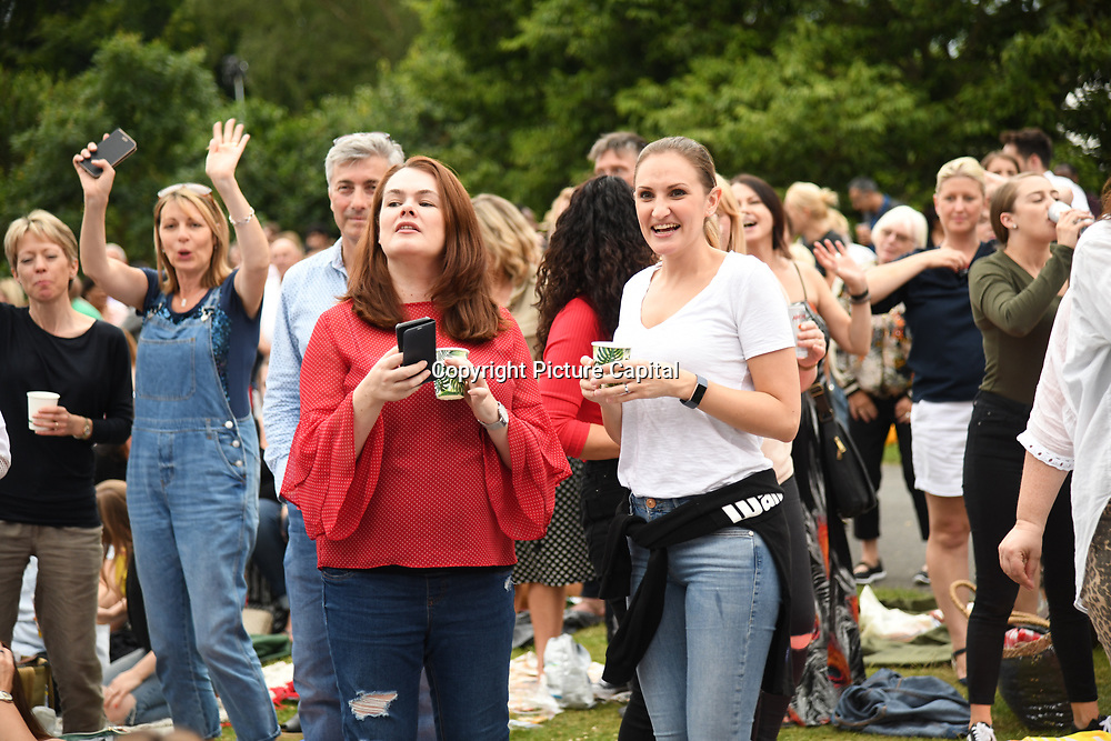 Attendees enjoy themselves at Kew The Music 2019 on 9 July 2019, Kew Garden, London, UK.