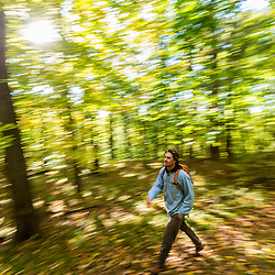 A young man walks a forest trail in Amesbury, Massachusetts.