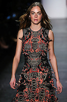 Alma Durand walks the runway wearing Vivienne Tam Fall 2016 during New York Fashion Week on February 15, 2016