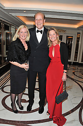 Left to right, LAURA REDVERS and EDWARD & REBECCA DUNLOP at the 22nd Cartier Racing Awards held at The Dorchester, Park Lane, London on 13th November 2012.