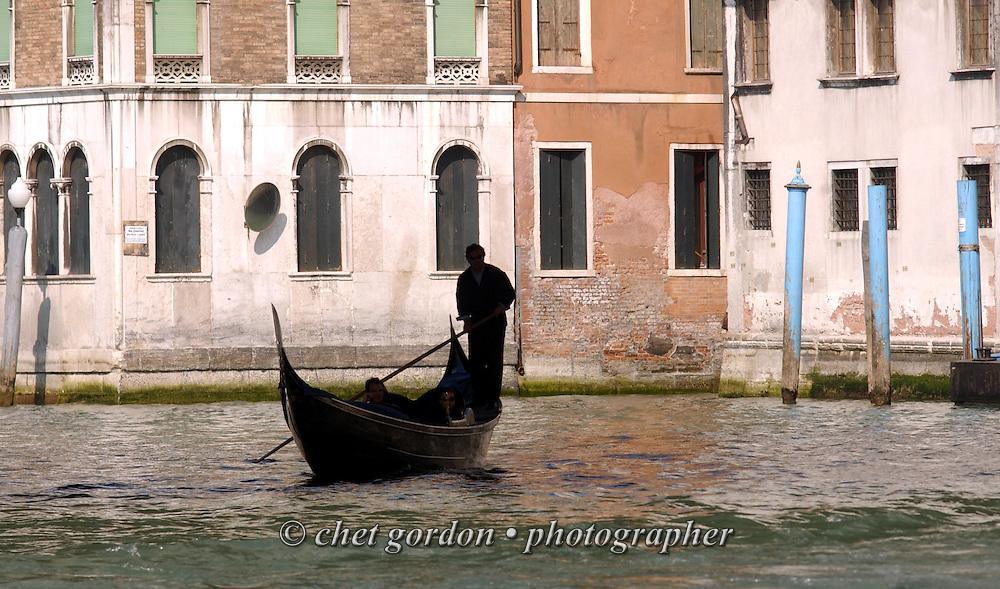 Gondola ride under the Rialto Bridge on the Grand Canal in Venice, Italy. April 2002.