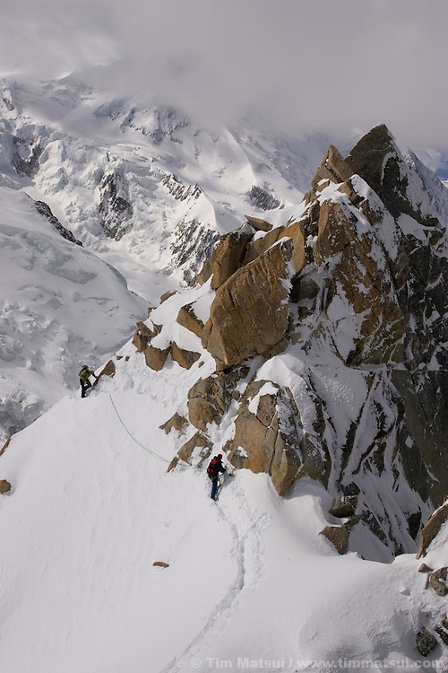Climbers on the Arete du Cosmique, Chamonix, France.