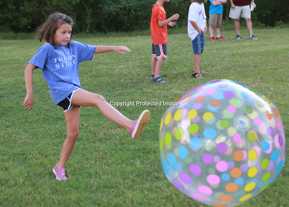 LIBBY EZELL | BUY AT PHOTOS.DJOURNAL.COM<br /> Laxy Hood, 8 kicks a giant beach ball at the Orchard's VBS Wednesday night
