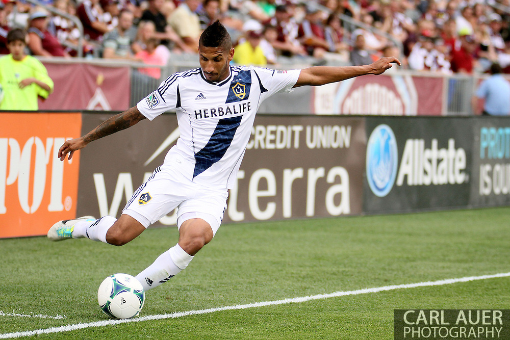 July 27th, 2013 - LA Galaxy defender Sean Franklin (5) attempts to cross a pass towards the goal in the second half of action in the Major League Soccer match between the LA Galaxy and the Colorado Rapids at Dick's Sporting Goods Park in Commerce City, CO