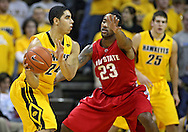January 27, 2010: Iowa forward Aaron Fuller (24) tries to pass the ball around Ohio State guard/forward David Lighty (23) during the first half of their game at Carver-Hawkeye Arena in Iowa City, Iowa on January 27, 2010. Ohio State defeated Iowa 65-57.
