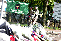 59686721.Flowers are laid at the entrance to the Royal Artillery Barracks in Woolwich in southeast London, May 23, 2013. A serving soldier was hacked to death by two attackers wielding knives including a meat cleaver near the Royal Artillery Barracks in Woolwich on Wednesday afternoon on May 23, 2013. Photo by: imago / i-Images. UK ONLY