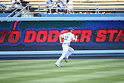 LOS ANGELES, CA - APRIL 28:  Clayton Kershaw #22 of the Los Angeles Dodgers runs a sprint in the outfield while warming up before the game against the Milwaukee Brewers on Sunday, April 28, 2013 at Dodger Stadium in Los Angeles, California. The Dodgers won the game 2-0. (Photo by Paul Spinelli/MLB Photos via Getty Images) *** Local Caption *** Clayton Kershaw