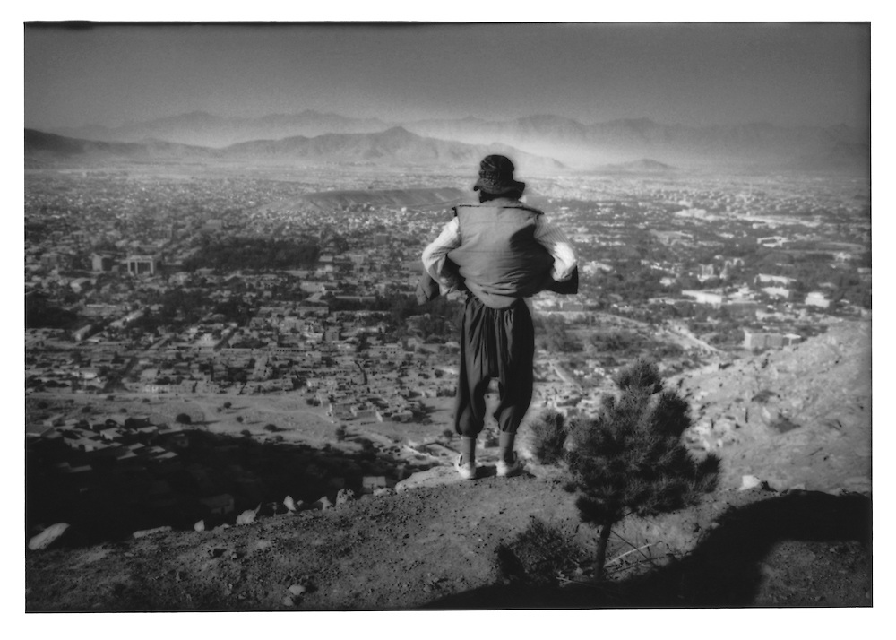 Man looks out over Kabul from Koh-e Asmai, Afghanistan.