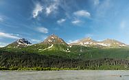Morning light on Chugach Mountains and Lowe River near Valdez in Southcental Alaska. Summer.