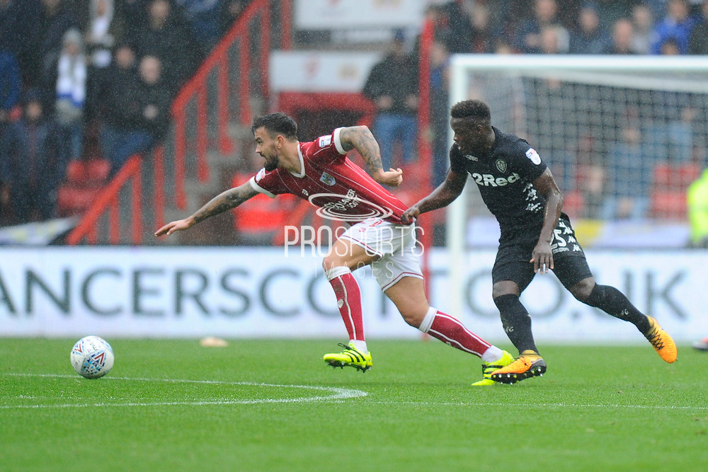 Ronaldo Vieira (25) of Leeds United tugs on the shirt of Marlon Pack (21) of Bristol City during the EFL Sky Bet Championship match between Bristol City and Leeds United at Ashton Gate, Bristol, England on 21 October 2017. Photo by Graham Hunt.