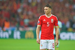 LILLE, FRANCE - Friday, July 1, 2016: Wales' James Chester in action against Belgium during the UEFA Euro 2016 Championship Quarter-Final match at the Stade Pierre Mauroy. (Pic by Paul Greenwood/Propaganda)