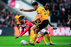 Kasey Palmer of Bristol City is tackled by Leander Dendoncker of Wolverhampton Wanderers - Mandatory by-line: Ryan Hiscott/JMP - 17/02/2019 - FOOTBALL - Ashton Gate Stadium - Bristol, England - Bristol City v Wolverhampton Wanderers - Emirates FA Cup fifth round proper