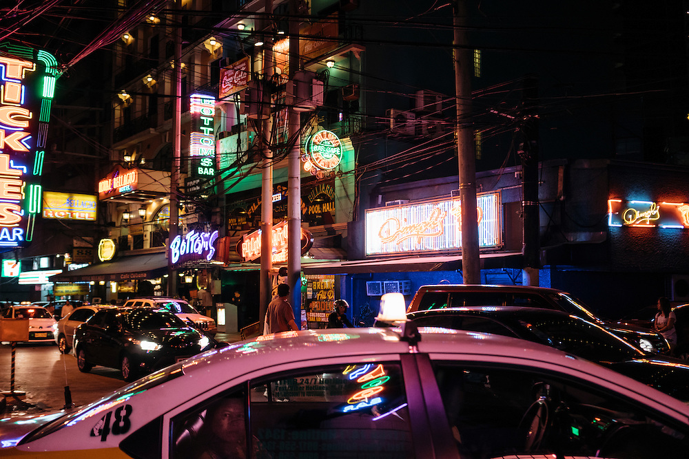Cars fill the roadways in the redlight district  on P Burgos Street, in Manila, Philippines. on March 3, 2016.