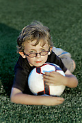 Portrait of boy with soccer ball.