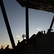 2017 U.S. Open Tennis Tournament - DAY ELEVEN. Spectators make their way into Arthur Ashe Stadium at sunset during the US Open Tennis Tournament at the USTA Billie Jean King National Tennis Center on September 07, 2017 in Flushing, Queens, New York City.  (Photo by Tim Clayton/Corbis via Getty Images)