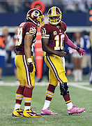 Washington Redskins quarterback Robert Griffin III (10) talks to Washington Redskins running back Roy Helu (29) during the NFL week 6 football game against the Dallas Cowboys on Sunday, Oct. 13, 2013 in Arlington, Texas. The Cowboys won the game 31-16. ©Paul Anthony Spinelli