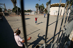 Sderot  - May 2nd ,  2008 -  Teenagers play ball games in the local School playground in the centre of Sderot, Southern Israel, The small town has frequent rocket attacks from Gaza  , May 2nd, 2008. Picture by Andrew Parsons / i-Images