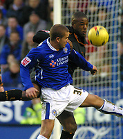 Photo: Dave Linney.<br />Leicester City v Wolverhampton Wanderers. Coca Cola Championship. 04/02/2006.Wolves striker Carl Court (R) beats  James Wesolowski to the ball